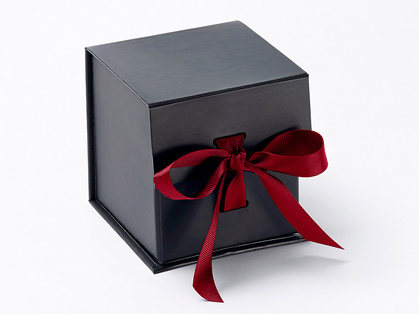 Black cube giftbox red ribbon