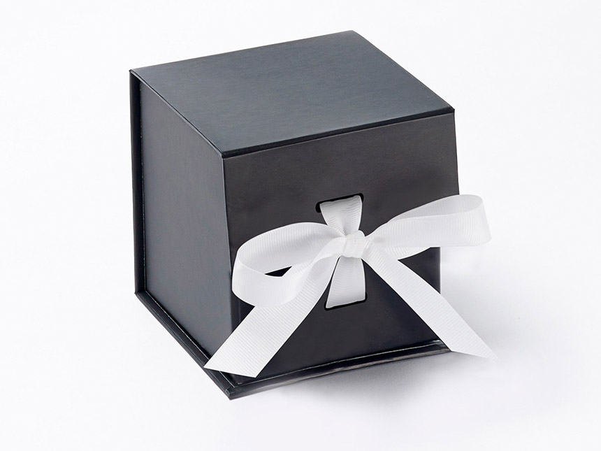 Black cube giftbox white ribbon